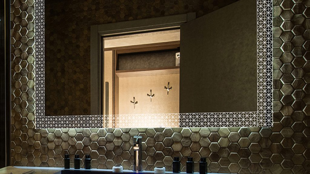 Grand Mirrors' Geometrical Etch Mirror in room with cool black and white accents