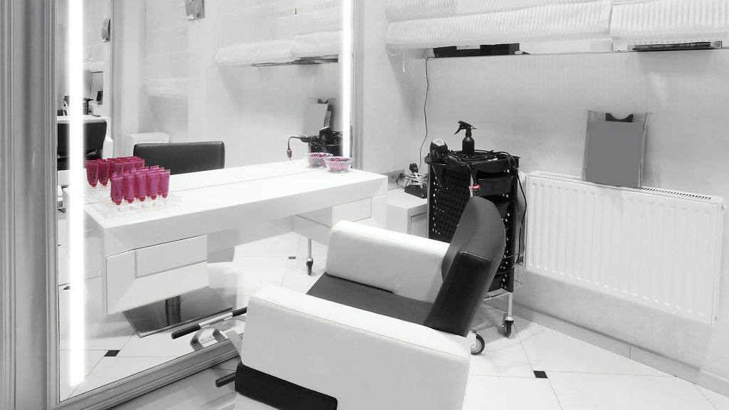 A bright salon with huge integrated light mirror