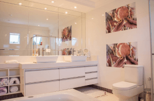 A bathroom that is well-furnished with accessories