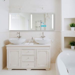 My Qaio Lighted Smart Mirror Installed in a bathroom sink of a modern luxury home