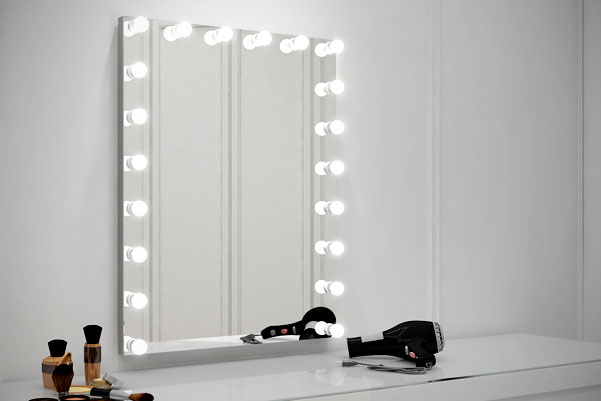 Lighted Hollywood Mirror by Grand Mirrors Inc. installed in a vanity room